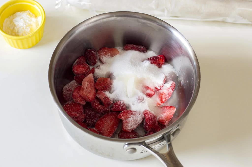 Strawberries in a pot with sugar on them