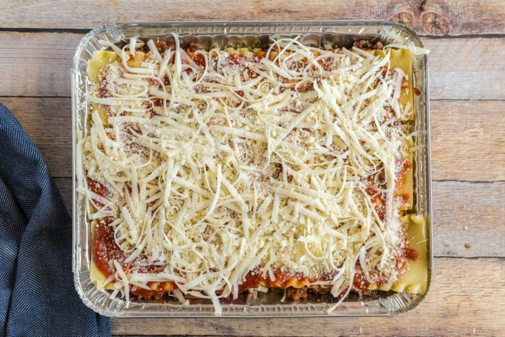 Easy Beef Lasagna with three layers and sprinkled with cheese