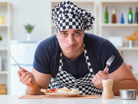 a puzzled man cook